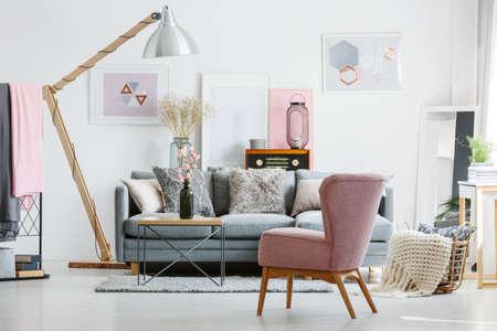 Foto de Stylish original living room with vintage radio and geometric posters - Imagen libre de derechos