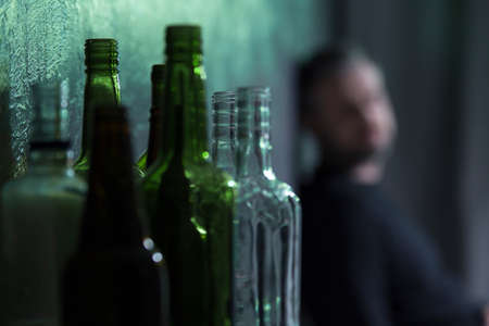 Photo pour Empty glass bottles of wine and beer. Alcohol problem concept - image libre de droit
