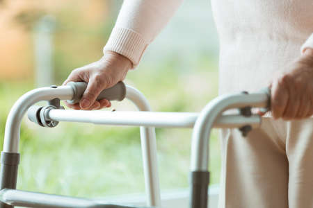 Photo pour Close up of senior person using a walker during rehabilitation at home - image libre de droit