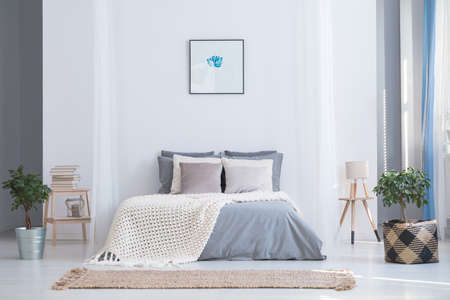 Photo for Soothing gray and blue color palette for balanced bedroom in cozy flat interior with plants and natural accessories - Royalty Free Image