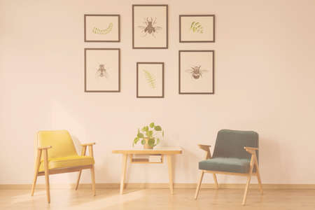 Photo pour Warm filter photo of vintage living room interior with wooden armchairs and table with plant against a wall with posters - image libre de droit