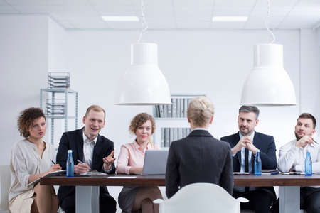Photo for Elegant businesswoman during a job interview with a group of recruiters in corporation - Royalty Free Image