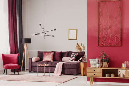Photo for Wooden cupboard and red armchair in cozy living room interior with mockup of empty poster - Royalty Free Image