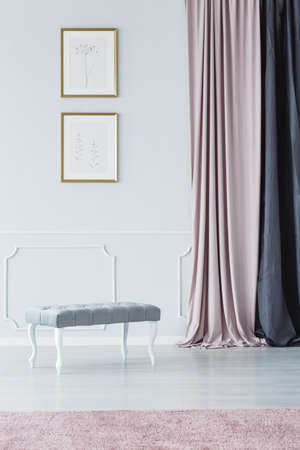 Photo pour Elegant, upholstered, bench style seat, long curtains and pale pink rug in a white, luxurious hallway interior - image libre de droit