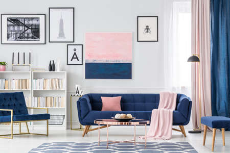 Photo for White, blue and pink living room interior with couch, paintings and curtains - Royalty Free Image
