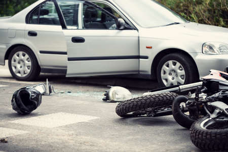 Photo for Car crash with a motorbike. Helmet and lights lying on the street - Royalty Free Image