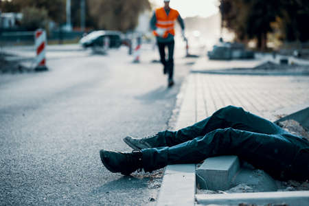 Photo pour Dead person on the street after an accident at roadworks. Result of non-compliance with health and safety regulations - image libre de droit