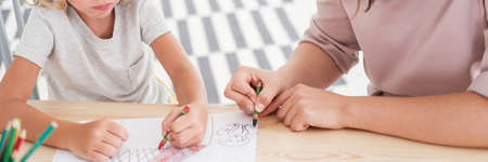 Foto de Close-up of kids drawing pictures during art classes at school - Imagen libre de derechos