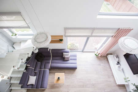 Photo for Top view of a living room interior with a comfy sofa, floor, glass door and tv. Real photo - Royalty Free Image