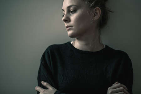 Foto de Portrait of young sad woman with anxiety disorder, anorexia ans loneliness concept - Imagen libre de derechos
