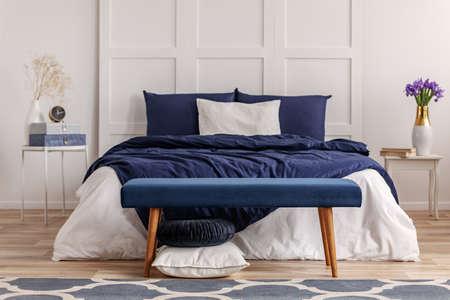 Foto de Navy blue bedroom interior in scandinavian apartment - Imagen libre de derechos