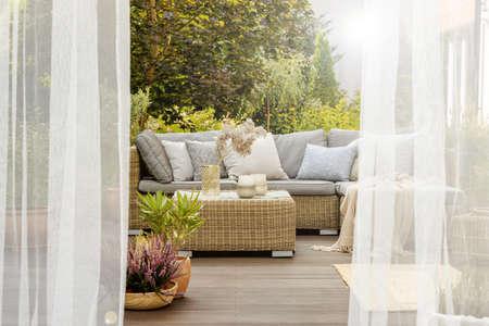 Foto de Modern designed cozy porch with rattan furniture and wooden floor - Imagen libre de derechos