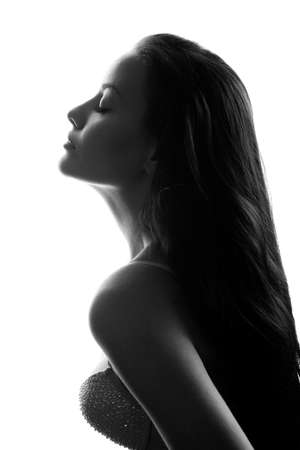 closeup silhouette of attractive caucasian woman wearing bra