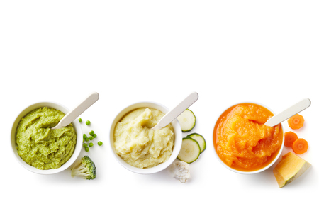 Photo pour Green, yellow and orange baby puree in bowl isolated on white background, top view - image libre de droit