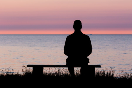 Photo for Silhouette of male person against a colorful horizon. - Royalty Free Image