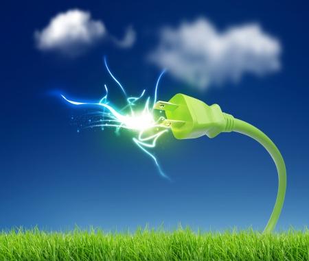 Foto de green plug with electricity  - Imagen libre de derechos