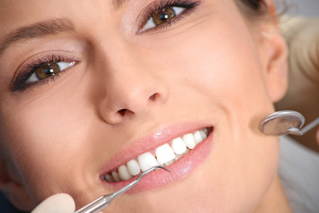 Photo for dental examination of attractive girl in the office of the dentist - Royalty Free Image