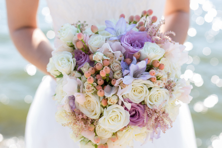 Foto de wedding bouquet in hands of the bride - Imagen libre de derechos