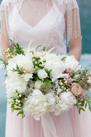 Foto de wedding bouquet with white peony and roses - Imagen libre de derechos