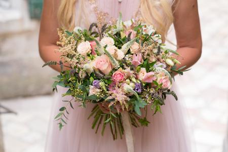 Foto de gorgeous rustic wedding bouquet of various flowers and herbs - Imagen libre de derechos