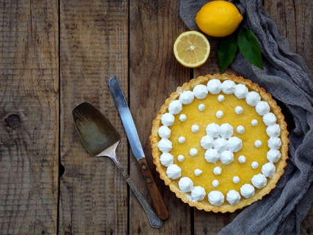 Photo for Lemon tart pie with meringue cream. Traditional American cake. Homemade baking. Copy space. - Royalty Free Image