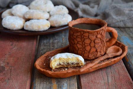 Foto de Sesame shortbread with date stuffing. Middle Eastern cookies. Eid and Ramadan Dates Sweets. Kahk. Arabian cuisine. Copy Space. - Imagen libre de derechos