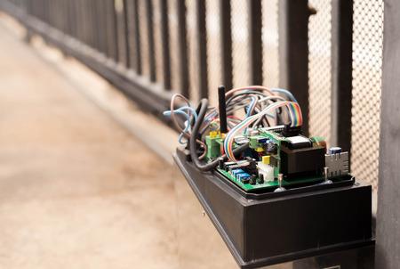 Foto de Electronic Gate control system motor with wires industrial - Imagen libre de derechos