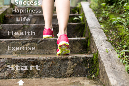 Photo pour Concept Health care Female jogging up the stairs in the park outside - image libre de droit