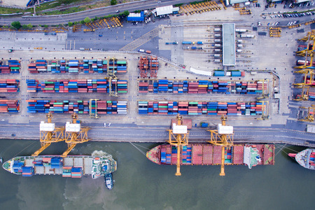 Photo for Aerial View Above the Bangkok Dockyard by the Chao Phraya River with Cargo Ships Waiting to be Upload and Offload Cargo Containers. - Royalty Free Image