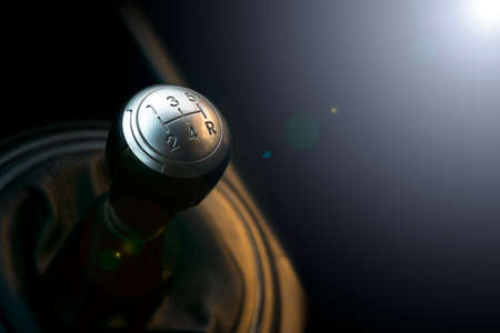 Photo pour Close up view of a gear lever shift. Manual gearbox. Car interior details. Car transmission. Soft lighting. Abstract view - image libre de droit