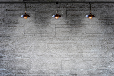 Photo for Granite stone decorative brick wall with lamp - Royalty Free Image