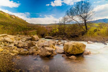 River source flowing inside big rocks in Iraqi Kurdistan region in Iraq