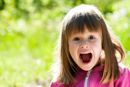 Photo for Close-up portrait of a little pretty girl with shouting face expression - Royalty Free Image