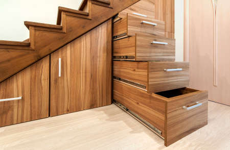 Photo pour Modern architecture interior with  luxury hallway with glossy wooden stairs in modern storey house. Custom built pullout cabinets on glides in slots under stairs - image libre de droit