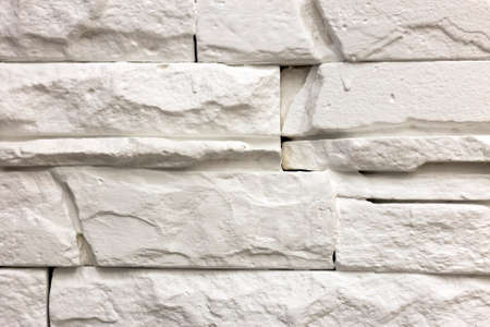 Photo pour Close-up of white solid limestone wall or stone fence. Abstract copy space background, Bricklaying, construction and masonry concept. - image libre de droit