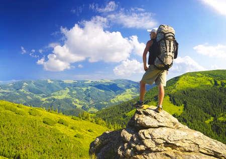 Foto de Tourist on the rock. Sport and active life concept - Imagen libre de derechos