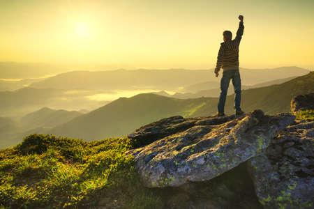 Photo pour Winner on the mountain top. Sport and active life concept - image libre de droit