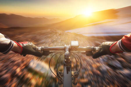 Foto de Fast ride on bike in mountain valley. Sport and active life concept - Imagen libre de derechos