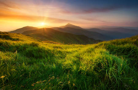 Foto de Mountain valley during sunrise. Natural summer landscape - Imagen libre de derechos