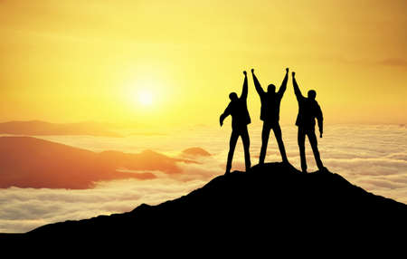 Photo for Silhouettes of team on mountain peak. Sport and active life concept - Royalty Free Image