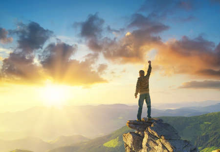 Foto de Silhouette of a champion on mountain peak. Active life concept - Imagen libre de derechos