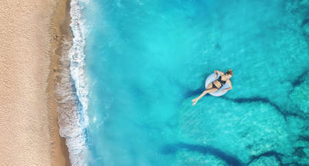 Photo for Aerial view at the girl on sea. Turquoise water from air as a background from air. Natural seascape at the summer time. Seascape from drone - Royalty Free Image