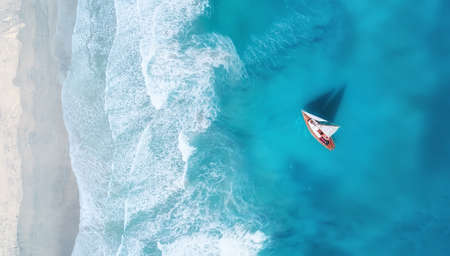 Photo for Yacht on the water surface from top view. Turquoise water background from top view. Summer seascape from air. Travel concept and idea - Royalty Free Image