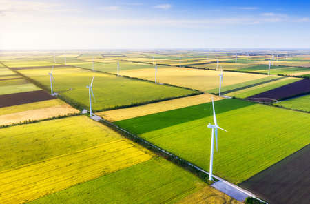 Foto de Wind power station on the field. Aerial view from drone. Concept and idea of alternative energy development. Technology - image - Imagen libre de derechos
