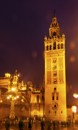 Giralda Spire, Bell Tower, Seville Cathedral, Rainy Night, Car Trails, Seville, Andalusia Spain Built in the 1500s Largest Gothic Cathedral in the World and Third Largest Church in the World Burial Place of Christopher Columbus Giralda is a former