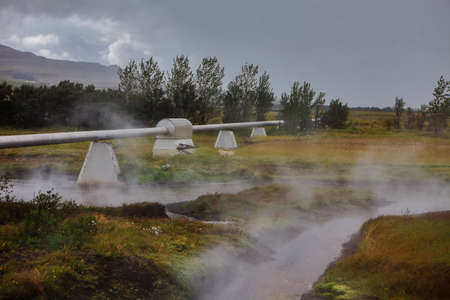 Photo pour Geothermal power station in Iceland. Generation of ecologically clean renewable energy. Landscape of geothermal sources and geothermal energy plant. - image libre de droit