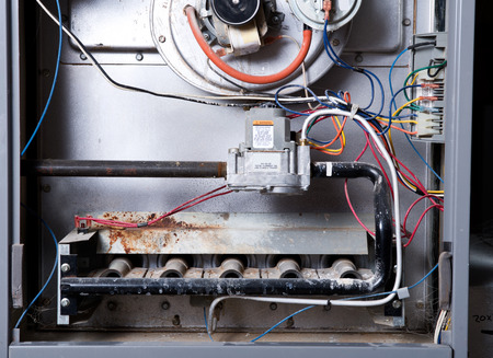 Photo pour Open home furnace just ready for cleaning and repair - image libre de droit