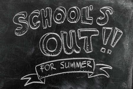 Foto de School's out for summer on blackboard - Imagen libre de derechos