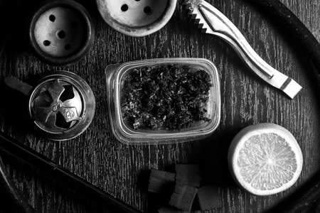 Photo for Hookah accessories on the table. Smoking Shisha. Relaxing enviro - Royalty Free Image