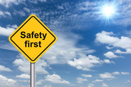 Photo pour safety first sign banner and clouds blue sky background - image libre de droit